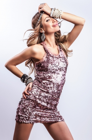 Young sensual   beauty woman in a fashionable dress