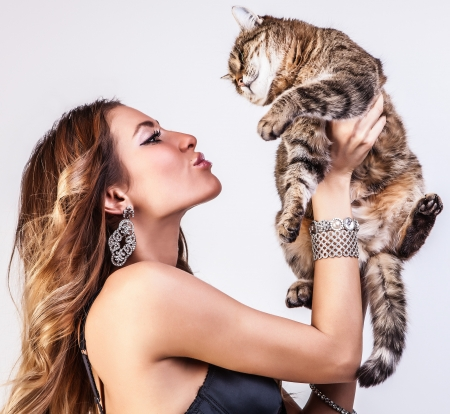 Beautiful woman with a cat   photo