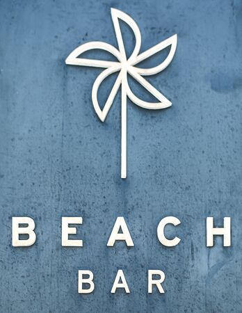 Sign  Beach Bar  on old blue stone wall  photo
