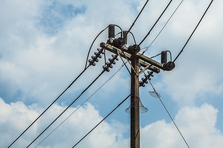 electric pole with wires with blue sky photo