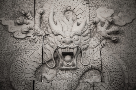 bust up: Traditional asian image cut from stone on a wall
