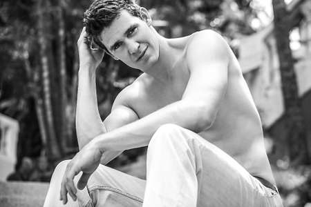 blackwhite: Adult attractive man relaxed on garden  Black-white photo