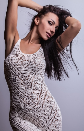 Attractive friendly brunette pose in studio    photo