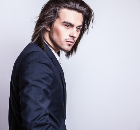 male model: Portrait of handsome long-haired stylish man