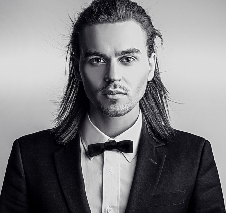 Portrait of handsome long-haired stylish man    photo
