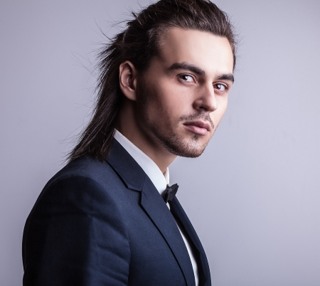 fashion models: Portrait of handsome long-haired stylish man