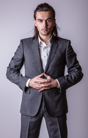 vogue style: Portrait of handsome long-haired stylish man