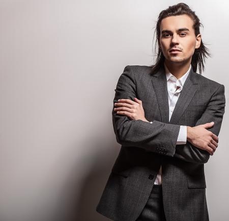 Portrait of handsome long-haired stylish man 版權商用圖片 - 20085275