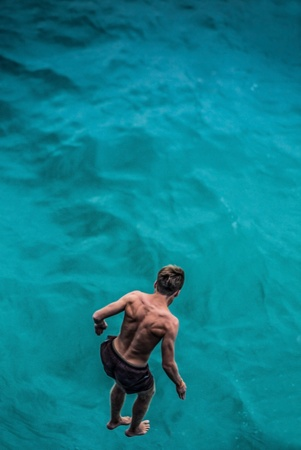 Man jumping into the water photo