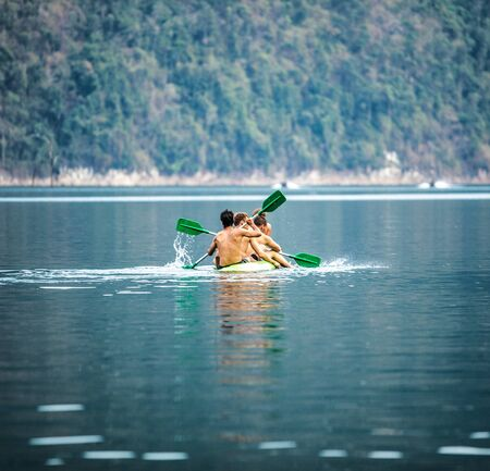 kao sok: Strong young men in kayak Stock Photo