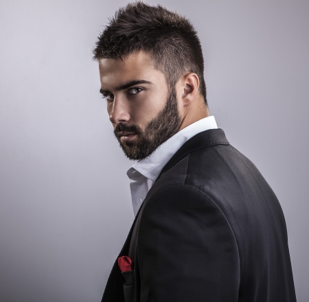 man hair: Elegant young handsome man  Studio fashion portrait