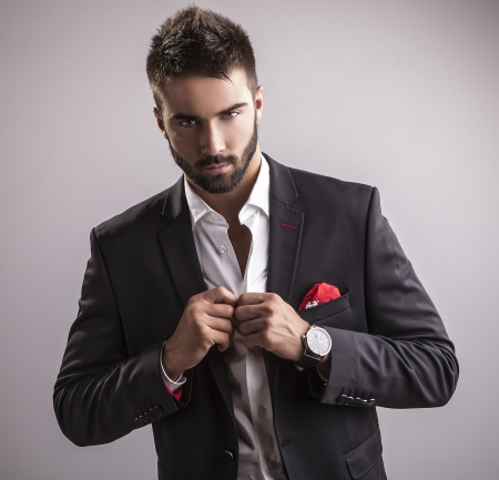 Elegant young handsome man  Studio fashion portrait