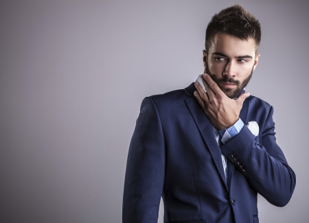 Elegant young handsome man  Studio fashion portrait 版權商用圖片 - 22572356