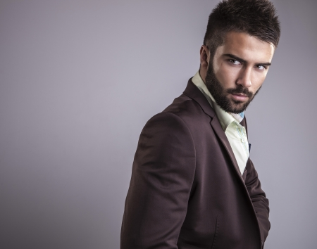 modeling: Elegant young handsome man  Studio fashion portrait