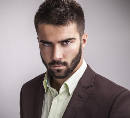 Elegant young handsome man  Studio fashion portrait