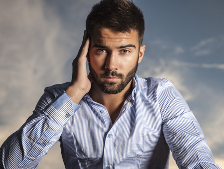 Portrait of young beautiful fashionable man outdoor   photo