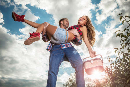 Positive young couple spending time outdoors    photo