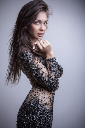 Young sensual   beauty woman in a fashionable dress    photo