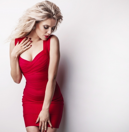 Fashion photo of young magnificent woman in luxury red dress    Stok Fotoğraf