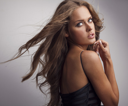 Young sensual   beauty woman in a fashionable black dress    photo