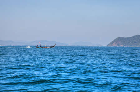 Wooden boat on sea photo