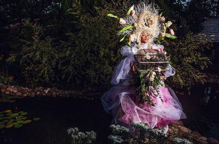 Fashion image of sensual girl in bright fantasy stylization  Outdoor fairy tale art photo  photo