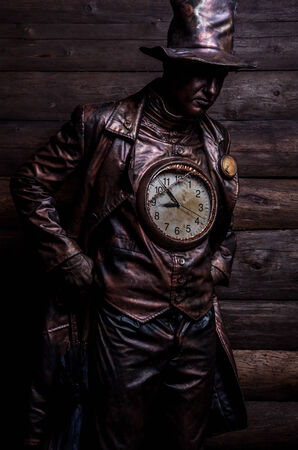 magic hour: Image of watchmaker in bright fantasy stylization  Fairy tale art photo on grunge wooden  Stock Photo