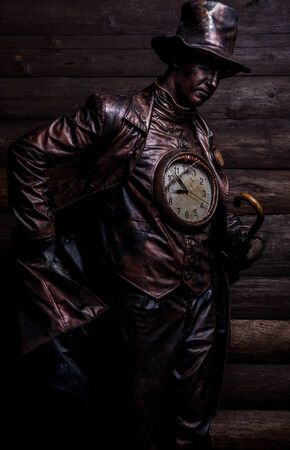 watchmaker: Image of watchmaker in bright fantasy stylization  Fairy tale art photo on grunge wooden  Stock Photo