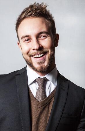 Elegant & Positive young handsome man in costume. Studio fashion portrait. photo