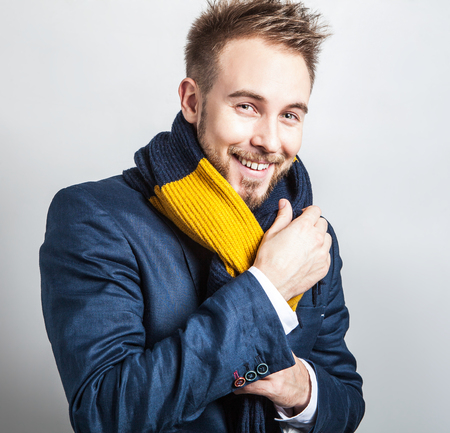 Elegant & Positive young handsome man in colorful scarf. Studio fashion portrait. photo