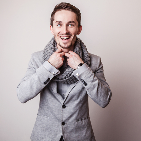 Elegant young handsome man in grey costume. Studio fashion portrait. photo
