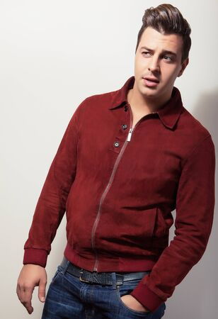 claret: Elegant young handsome man in claret suede jacket. Studio fashion portrait. Stock Photo