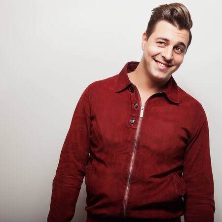 claret: Elegant young handsome man in claret suede jacket. Studio fashion portrait. Stock Photo