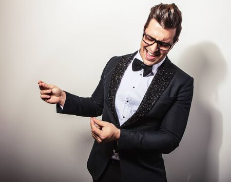 Elegant young handsome man in black luxury costume. Studio fashion portrait. photo
