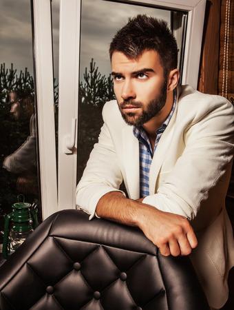 Attractive men indoor. Closeup photo. photo