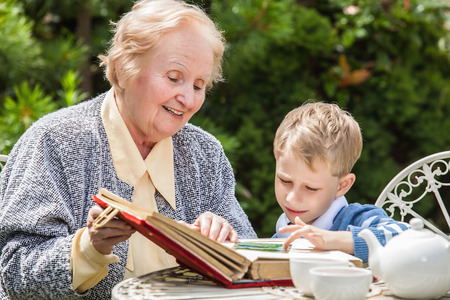 grandmother: Positive grandmother and grandson spent time together in summer solar garden.