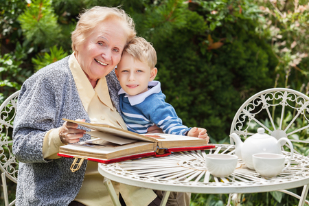 spent: Positive grandmother and grandson spent time together in summer solar garden.