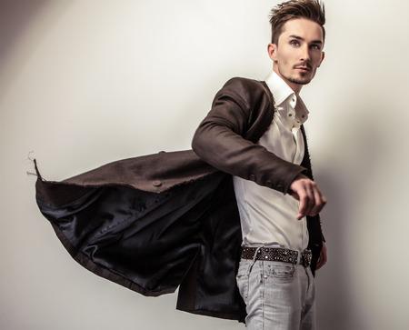 handsome man: Elegant handsome man in stylish coat