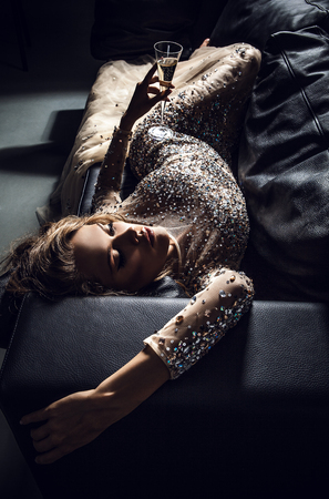 sensual: Elegant young woman in luxury dress