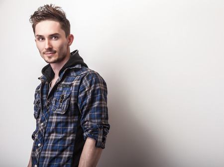 stylish: Studio portrait of young handsome man in stylish dark blue jacket.