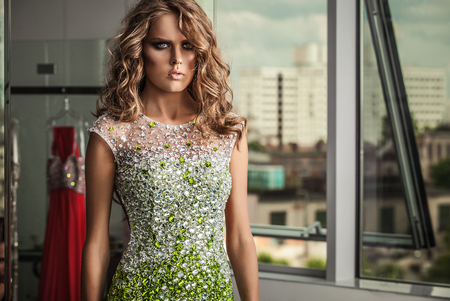 glamour luxury: Elegant young woman in luxury dress