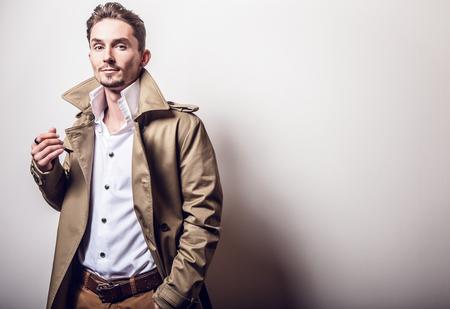handsome men: Elegant man in long stylish coat