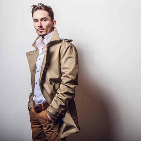 stylish men: Elegant man in long stylish coat