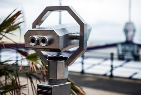 brige: Telescope on Hague bridge in cloudy autumn day.