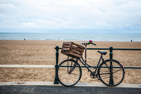 land locked: Old style bicycle with basket on coast of the North Sea in The Hague, Netherlands.