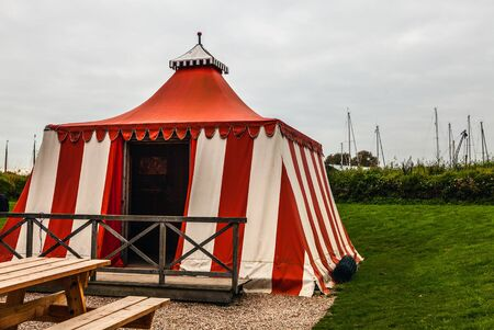 tarpaulin: Ancient white-red tarpaulin tent in Muiderslot castle. Holland. Editorial