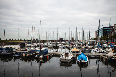city park boat house: NETHERLANDS, AMSTERDAM - OKTOMBER 24, 2015: Channel with parking boat in Amsterdam.