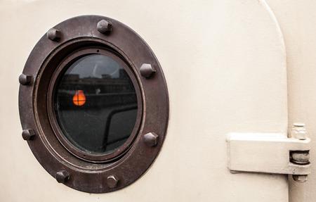 Brass porthole - ferry window frame. Stock Photo
