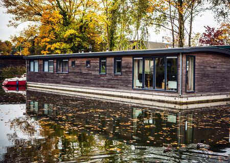 house float on water: House on water. Muiderslot - Holland.