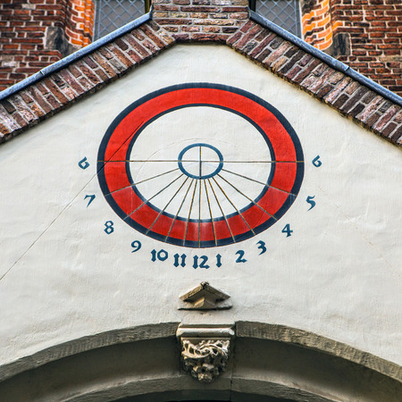 shooters: Ancient sundial. Utrecht - Holland. Stock Photo